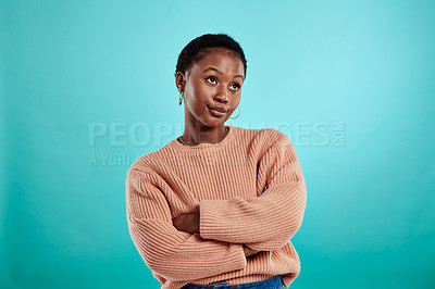 Buy stock photo Shot of a woman standing with her arms crossed against a turquoise background