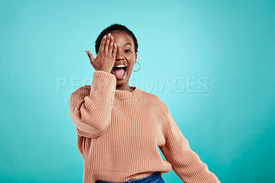 Buy stock photo Shot of a young woman holding her hand over her eye