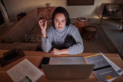 Buy stock photo Shot of a young working from home at night