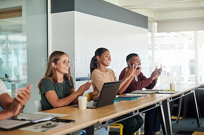 Buy stock photo Cropped shot of a group of young businesspeople applauding while sitting in the boardroom during a seminar
