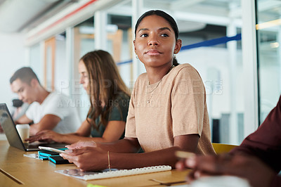 Buy stock photo Cropped shot of an attractive young businesswoman sitting in the boardroom with her colleagues during a seminar