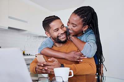Buy stock photo Shot of a young couple being affectionate and using a laptop  together at home