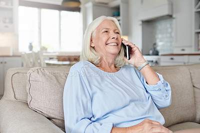Buy stock photo Shot of a senior woman talking on a cellphone at home