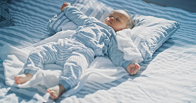 Buy stock photo Shot of an adorable baby girl sleeping on a bed at home