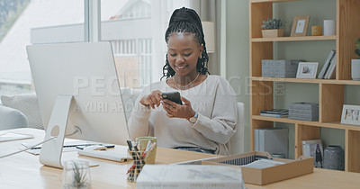 Buy stock photo Shot of a young woman using a phone while working from home