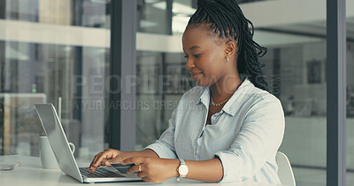 Buy stock photo Shot of a young woman using her laptop to pay some of her bills in a modern office