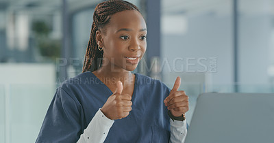 Buy stock photo Shot of a young female doctor using her laptop to do a telehealth video conference