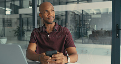 Buy stock photo Shot of a young man lost in thought while using his cellphone in a modern office