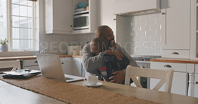 Buy stock photo Shot of a mature man and his grandson hugging in the kitchen at home