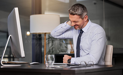 Buy stock photo Shot of a businessman suffering with neck pain while working at his desk