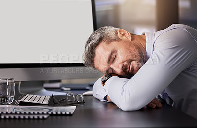 Buy stock photo Shot of a mature businessman sleeping with his head on his desk