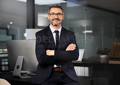 Buy stock photo Portrait of a businessman standing with his arms crossed in his office
