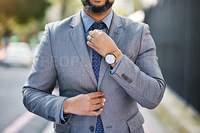 Buy stock photo Shot of a businessman wearing a suit while out in the city