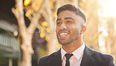 Buy stock photo Shot of a young businessman walking outside