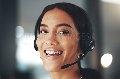 Buy stock photo Shot of a young call centre agent sitting alone in her office