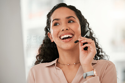 Buy stock photo Shot of a young female call center agent in an office at work