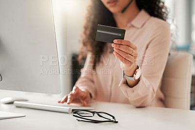 Buy stock photo Cropped shot of an unrecognizable call center agent using a credit card at work