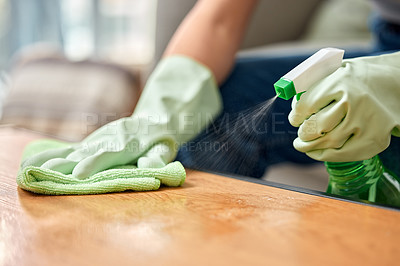 Buy stock photo Shot of an unrecognizable person cleaning a table at home