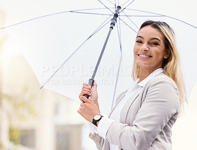 Buy stock photo Cropped portrait of an attractive young businesswoman walking through the city with an umbrella