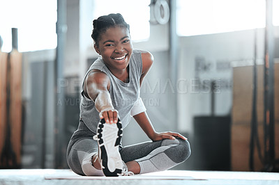 Buy stock photo Portrait of a young beautiful woman doing stretches and exercising at the gym