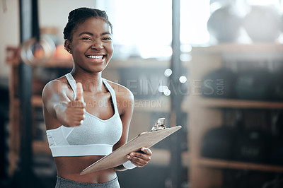 Buy stock photo Portrait of a young beautiful woman using a digital tablet and showing the thumbs up at the gym
