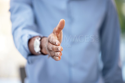 Buy stock photo Cropped shot of a businessman reaching out for a handshake