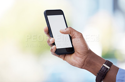 Buy stock photo Cropped shot of a businessman using his cellphone