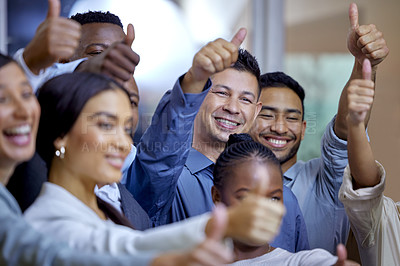 Buy stock photo Shot of a group of businesspeople showing the thumbs up in a modern office
