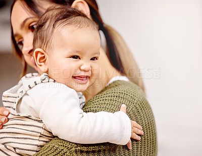 Buy stock photo Shot of a young mother holding her baby