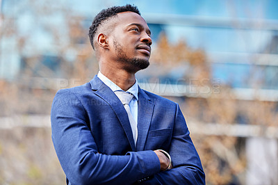 Buy stock photo Shot of a confident young businessman out in the city