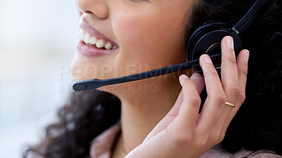 Buy stock photo Cropped shot of an unrecognizable call centre agent sitting alone in her office during the day