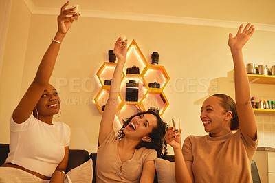 Buy stock photo Shot of a group of female friends having shots together