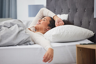 Buy stock photo Shot of a young woman in bed at home