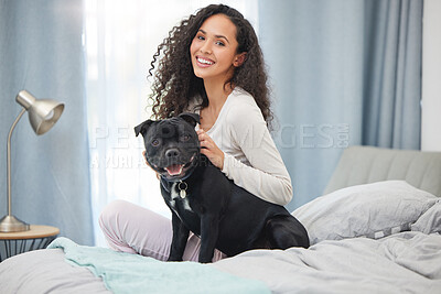 Buy stock photo Shot of a young woman and her dog  in bed at home