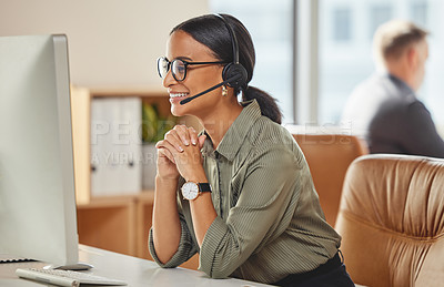 Buy stock photo Shot of a young businesswoman working on a computer in a call centre