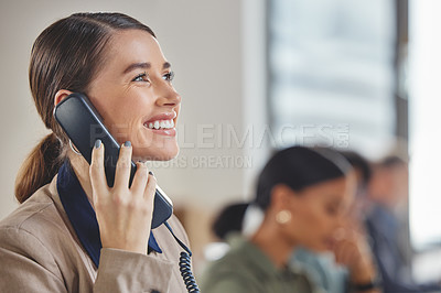 Buy stock photo Shot of a young businesswoman talking on a telephone while working in a call centre