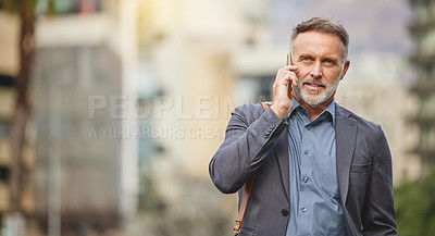Buy stock photo Shot of a mature businessman using his smartphone to make a phone call