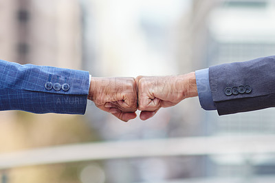 Buy stock photo Cropped shot of two unrecognizable businessmen fist bumping outside