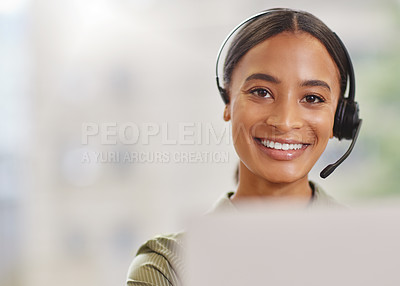 Buy stock photo Shot of a call centre agewnt smiling while sitting at her desk