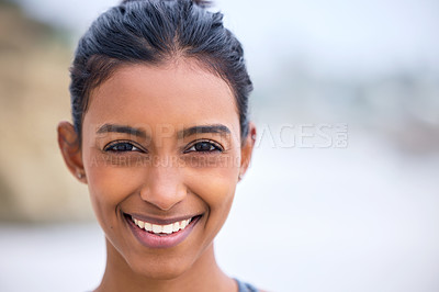 Buy stock photo Closeup shot of an attractive young woman practicing yoga on the beach