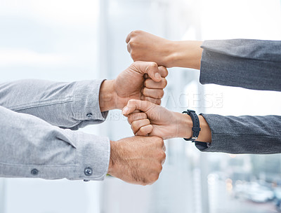 Buy stock photo Shot of two businesspeople stacking their fists on top of each other