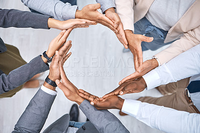 Buy stock photo Shot of a group of businesspeople joining their hands to form a circle