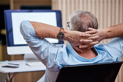 Buy stock photo Shot of an unrecognizable businessman sitting alone in his office and feeling accomplished while using his computer