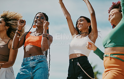Buy stock photo Shot of a group of friends spending a day in the city