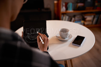 Buy stock photo Shot of a young woman drawing a coffee cup on her digital tablet