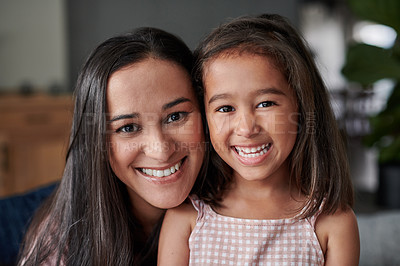 Buy stock photo Shot of a young mother spending time with her daughter at home