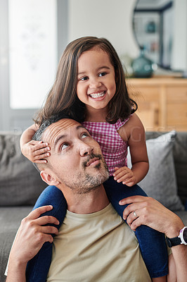 Buy stock photo Shot of a young father spending time with his daughter at home