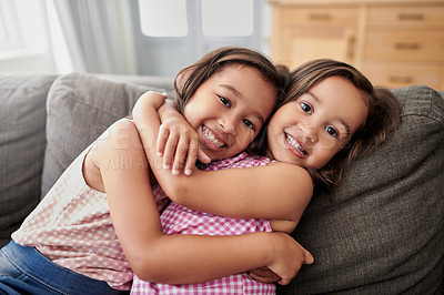 Buy stock photo Shot of two little girls hugging at home