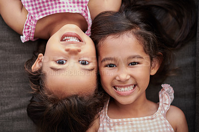 Buy stock photo Aerial shot of two little girls laying on the couch at home