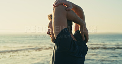 Buy stock photo Shot of a mature man stretching his arms while exercising along the beach